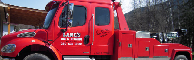 lanes auto towing red truck